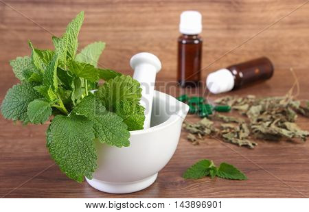 Dried And Fresh Lemon Balm In Mortar And Medical Capsules, Choice Between Pills And Alternative Medi