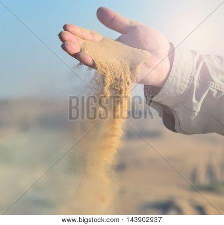 Sand In Hands Of Desert