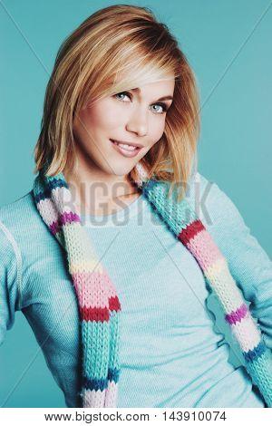 Blond woman wearing winter scarf