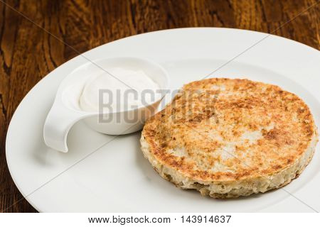 Hash brown with sour cream