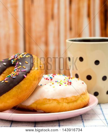 Donut And Coffee Indicates Fatty Food And Delicious