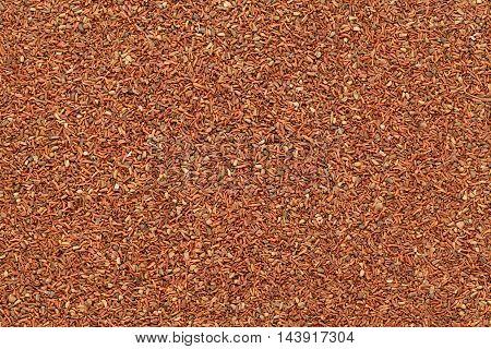 Organic Mahogany or Red Eucalyptus (Eucalyptus globulus) seeds. Macro closeup background texture. Top View.