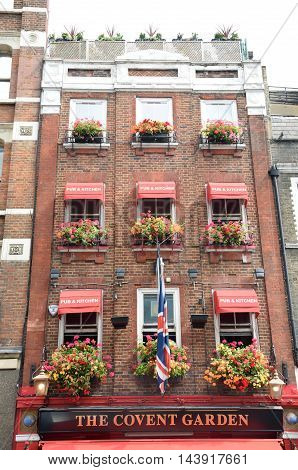Covent Garden London England United Kingdom - August 16 2016: Covent Garden Pub with Flower Baskets