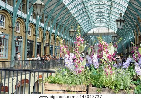 Covent Garden London England United Kingdom - August 16 2016: Central Piazza Convent Garden with Flowers in Foreground