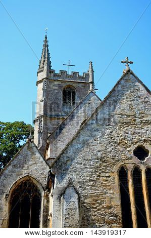 View of St Andrews church in the village centre Castle Combe Wiltshire England UK Western Europe.
