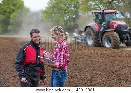 a farmer dealing with pesticide with woman