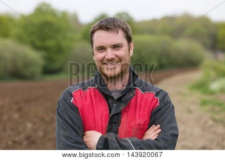 portrait of happy farmer in his field