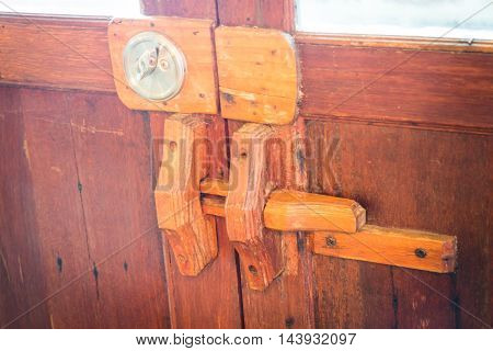 Wooden vintage double locked door stock photo