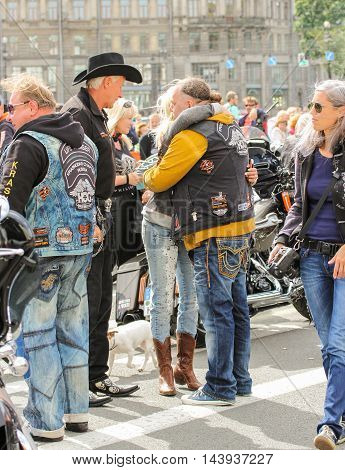 St. Petersburg, Russia - 13 August, The meeting familiar people,13 August, 2016. The annual International Motor Festival Harley Davidson in St. Petersburg.
