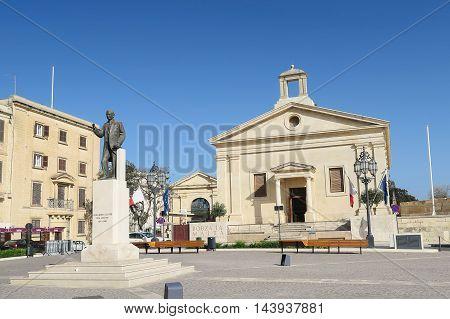 VALLETTA, MALTA AUGUST 02 2016. Malta Stock exchange building and square. The statue depicts former Maltese Prime Minister Giorgio Borg Olivier.