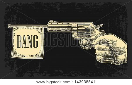Male hand holding revolver with bang flag. Vector engraving vintage illustrations. Isolated on dark background. For tattoo, web, shooting club and label