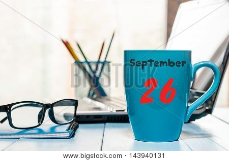 September 26th. Day 26 of month, calendar on Engineer workplace background. Autumn time. Empty space for text.