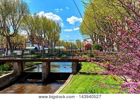Perpignan France - April 8, 2016: Spring in the Perpignan city. View to the city Canal of Perpignan. Pyrenees-Orientales France
