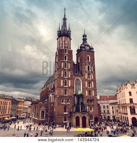 Church of St. Mary in the main Market Square in cloudy weather. Basilica Mariacka. Dramatic sky. Krakow. Poland.