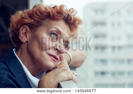 Worried middle aged woman on the balcony