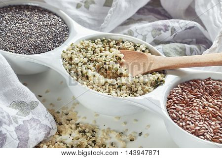 Hemp flax and chia seeds in bowl on white background. Vegan sources of Omega-3