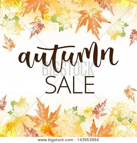 Autumn sale hand written inscription on fall leaves background