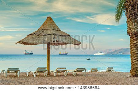 Relaxing atmosphere at the central public beach in Eilat - famous resort city in Israel