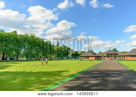 GLASGOW SCOTLAND - JULY 21 2016: People playing barefoot bowls at the Kelvin Grove Bowling and Tennis Centre in summer.