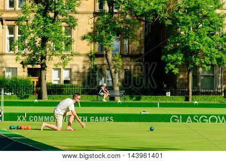 GLASGOW, SCOTLAND - JULY 21, 2016: People playing barefoot bowls at the Kelvin Grove Bowling and Tennis Centre in summer.