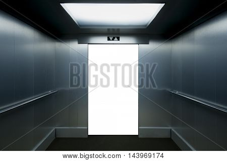 Interior view of a modern elevator with open doors isolated on white