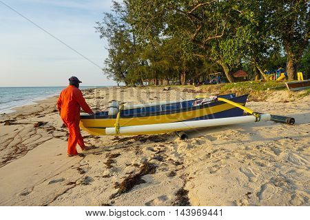 Labuan,Malaysia-Aug 24,2016:Local fishing men in his boat preparing for a day of fishing at Labuan island,Malaysia.Labuan local fishers provide a supply of fresh fish to the domestic village market.