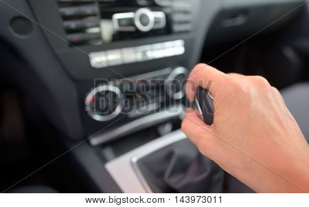 man driver hand shifting the gear stick