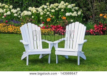 Adirondack Chairs in the flower Garden on Mackinac Island Michigan USA