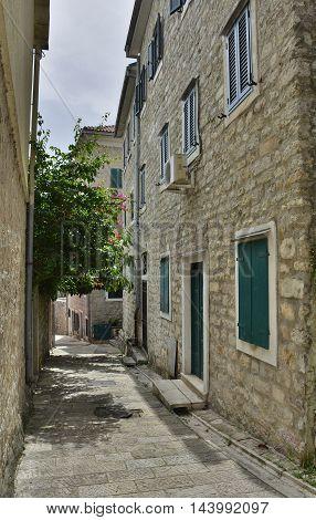An narrow old historic road in Herceg Novi Old Town Montenegro.