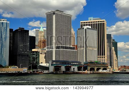 New York City - August 27 2015: Modern corporate towers and the Staten Island Ferry terminals at the tip of Manhattan island *