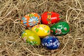 Six colorful easter eggs in laid hay poster