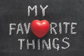 my favorite things phrase handwritten on blackboard with heart symbol instead of O poster