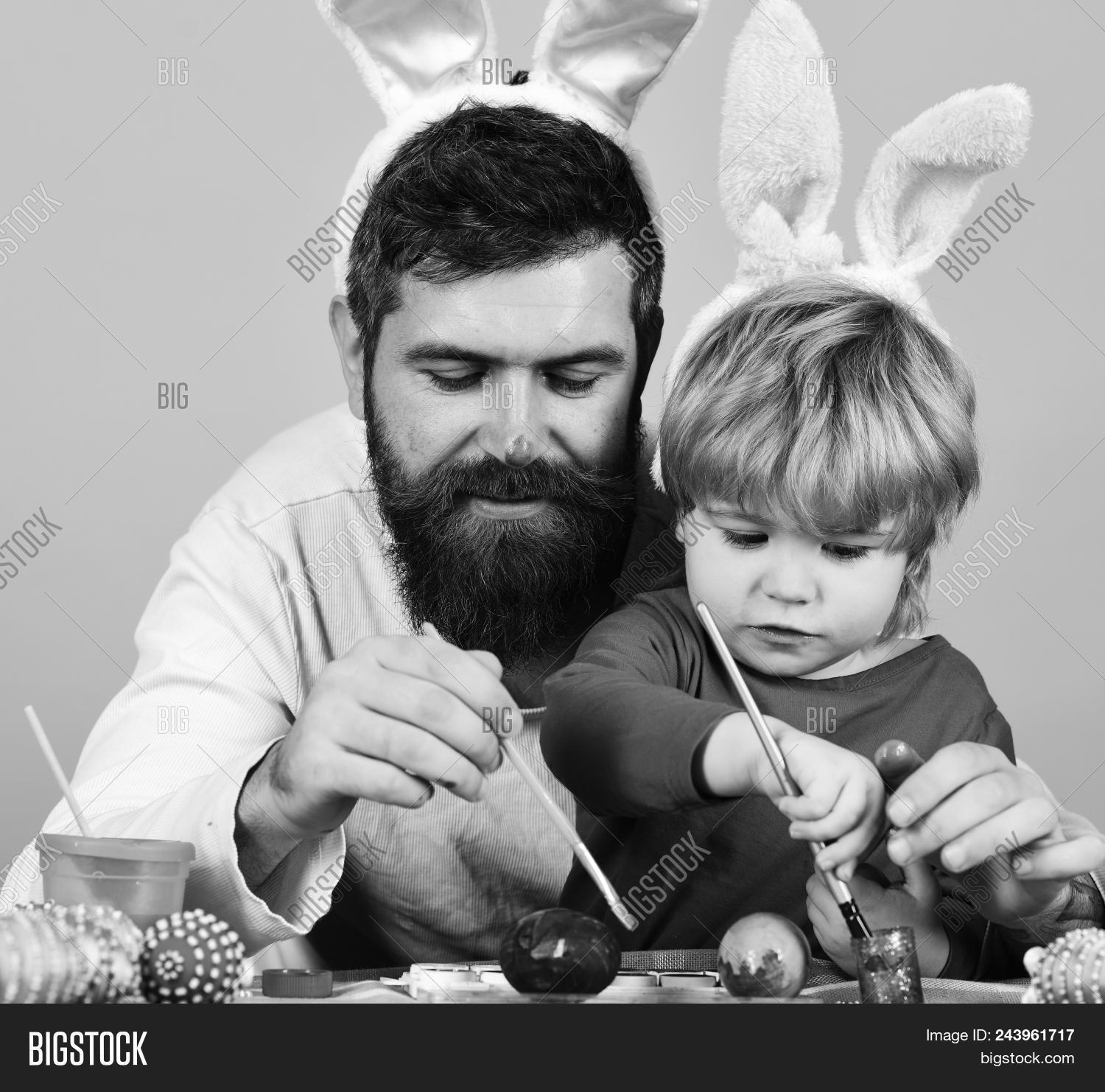 Father and son preparing for holiday easter celebration and joy concept dad with painted