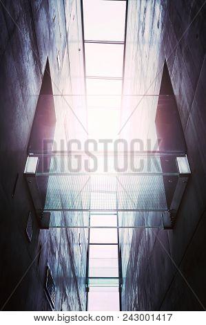 Futuristic Glass Footbridge Against The Sun, Color Toning Applied.