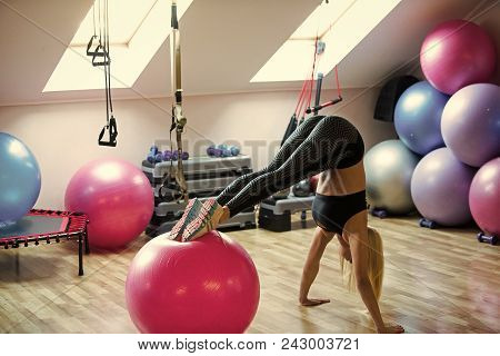 Girl Powered. Issues Face Girls. Woman Athlete Do Handstand With Legs On Fit Ball. Girl In Sportswea