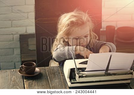 Happy Kid Having Fun. Small Boy Or Businessman Child Sitting At Table And Typing Typewriter With Pap