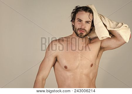 Man Face Handsome. Man With Wet Hair Hold Towel After Shower. Morning Washing, Wake Up, Everyday Lif