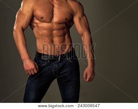Mens Heals Body Care. Athletic Bodybuilder Man On Grey Background. Sport And Workout. Dieting And Fi