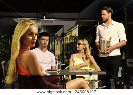 Sensual Woman Body. Friends Drink Champagne In Cafe Outdoor. Men And Sensual Twin Women In Bar On Su