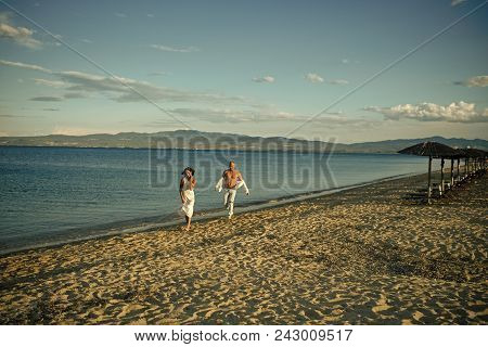 Sexy Couple. Man And Woman Walking, Couple Happy On Vacation. Couple In Love Running On Beach, Seash