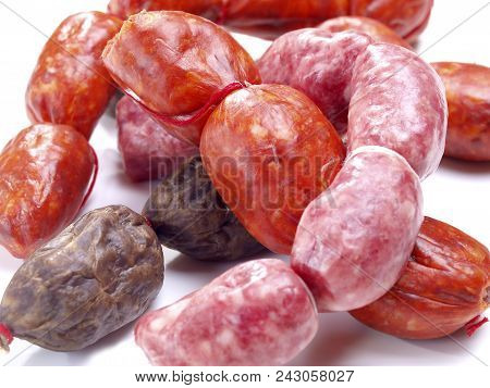 Raw Snack Size Sausages  Assortment Of Snack Size Sausages With Red Spicy Sausages, Black Onion Saus