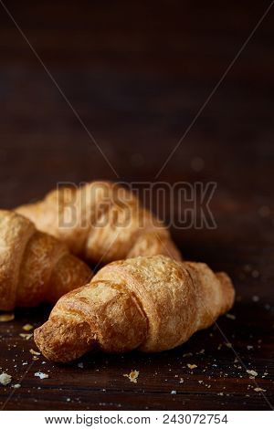 Tasty Buttery Croissants On An Old Wooden Table, Close-up, Selective Focus, Shallow Depth Of Field.