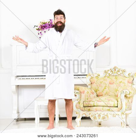 Happy Morning Concept. Man With Beard Enjoys Morning While Stand Near Piano And Old Fashioned Armcha