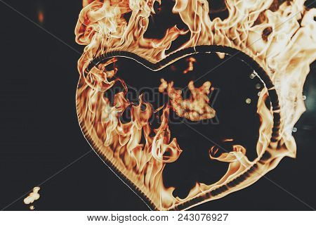 Burning Heart Close-up With Flames, Amazing Fire Show At Night At Festival Or Wedding Party. Fire Sh