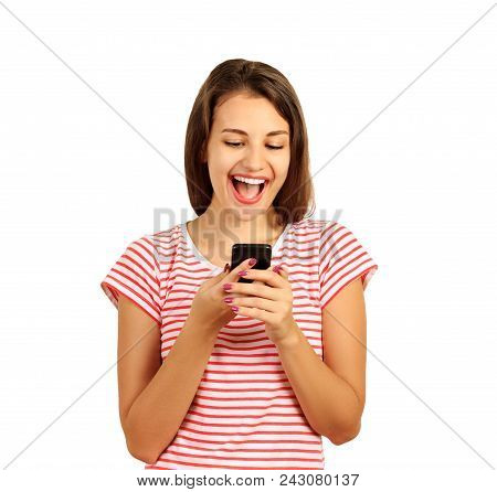 Beautiful Woman Looks In A Mobile Phone And Is Happy, Good News In A Message On The Phone. Emotional