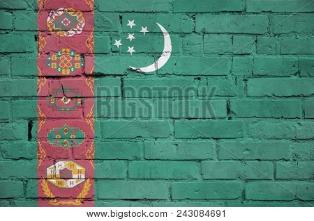 Turkmenistan Flag Is Painted Onto An Old Brick Wall