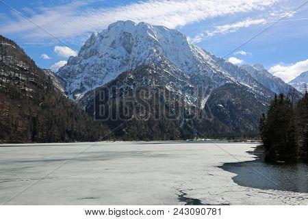 Landscape Of Frozen Alpine Lake In Northern Italy Called Lago Predil Near Austrian And Slovenia Bord