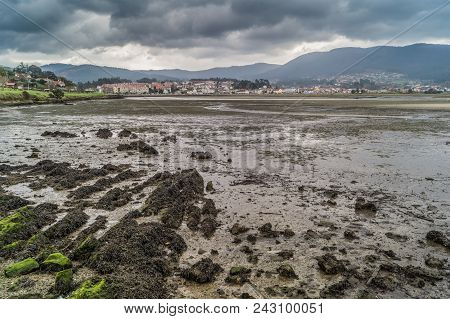 Low Tide Under The Storm In Ramallosa