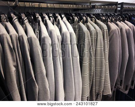 Rows of men's suit ,jackets in suit shop