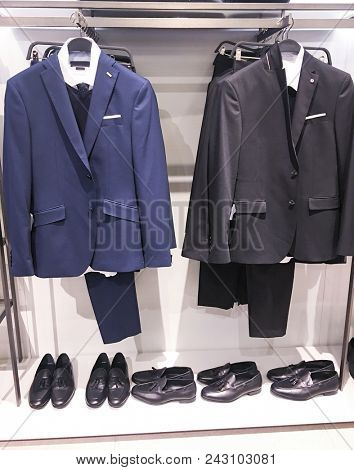 Two Mannequins in Coat and Suit,shoes, in shop
